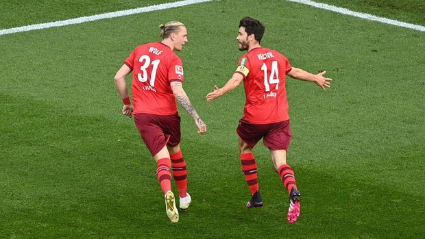 COLOGNE, GERMANY - APRIL 20: Jonas Hector of 1.FC Koeln  celebrates with Marius Wolf after scoring their team's second goal  during the Bundesliga match between 1. FC Koeln and RB Leipzig at RheinEnergieStadion on April 20, 2021 in Cologne, Germany. Sporting stadiums around Germany remain under strict restrictions due to the Coronavirus Pandemic as Government social distancing laws prohibit fans inside venues resulting in games being played behind closed doors. (Photo by Lukas Schulze/Getty Images)