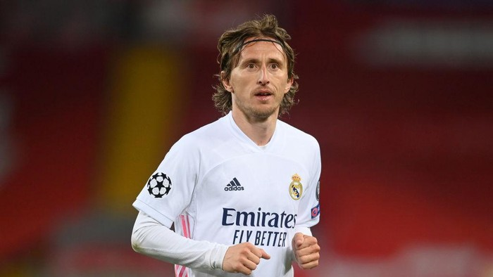LIVERPOOL, ENGLAND - APRIL 14: Luka Modric of Real Madrid looks on during the UEFA Champions League Quarter Final Second Leg match between Liverpool FC and Real Madrid at Anfield on April 14, 2021 in Liverpool, England. Sporting stadiums around the UK remain under strict restrictions due to the Coronavirus Pandemic as Government social distancing laws prohibit fans inside venues resulting in games being played behind closed doors. (Photo by Michael Regan/Getty Images)