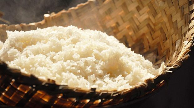 Hot sticky rice  in traditional wooden steamer - southeast asian food