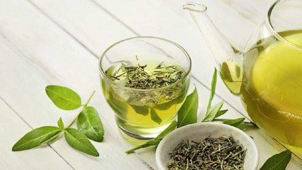 tea cup with tea leaves