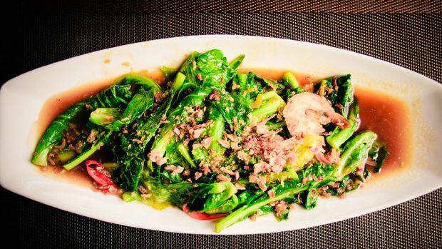 thai Stir-fried fresh baby kailan with prawn, garlic and oyster sauce.