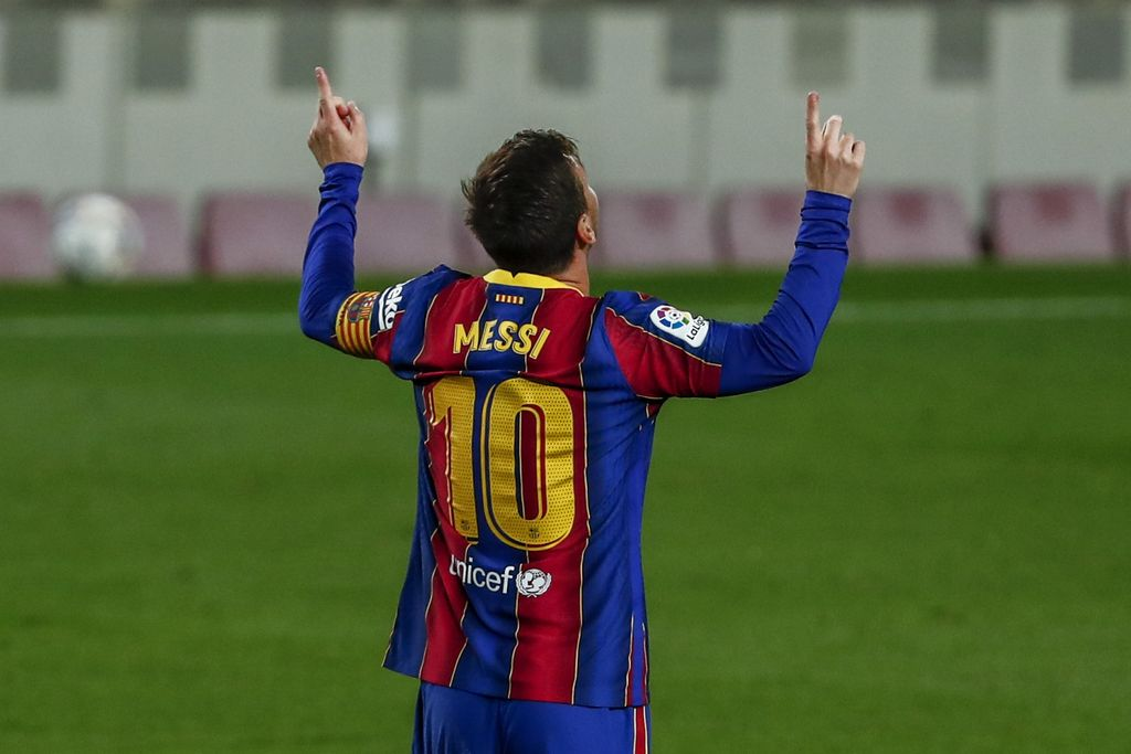Barcelona's Lionel Messi celebrates after scoring the opening goal during the Spanish La Liga soccer match between FC Barcelona and Getafe at the Camp Nou stadium in Barcelona, Spain, Thursday, April 22, 2021. (AP Photo/Joan Monfort)