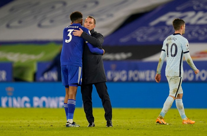 LEICESTER, ENGLAND - JANUARY 19: Wesley Fofana of Leicester City and Brendan Rogers, Manager of Leicester City embrace after the Premier League match between Leicester City and Chelsea at The King Power Stadium on January 19, 2021 in Leicester, England. Sporting stadiums around the UK remain under strict restrictions due to the Coronavirus Pandemic as Government social distancing laws prohibit fans inside venues resulting in games being played behind closed doors. (Photo by Tim Keeton - Pool/Getty Images)