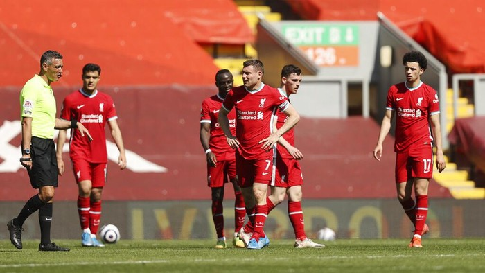 Liverpool players reacts after Newcastles Joe Willock scored during the English Premier League soccer match between Liverpool and Newcastle United at Anfield stadium in Liverpool, England, Saturday, April 24, 2021. (Clive Brunskill, Pool via AP)