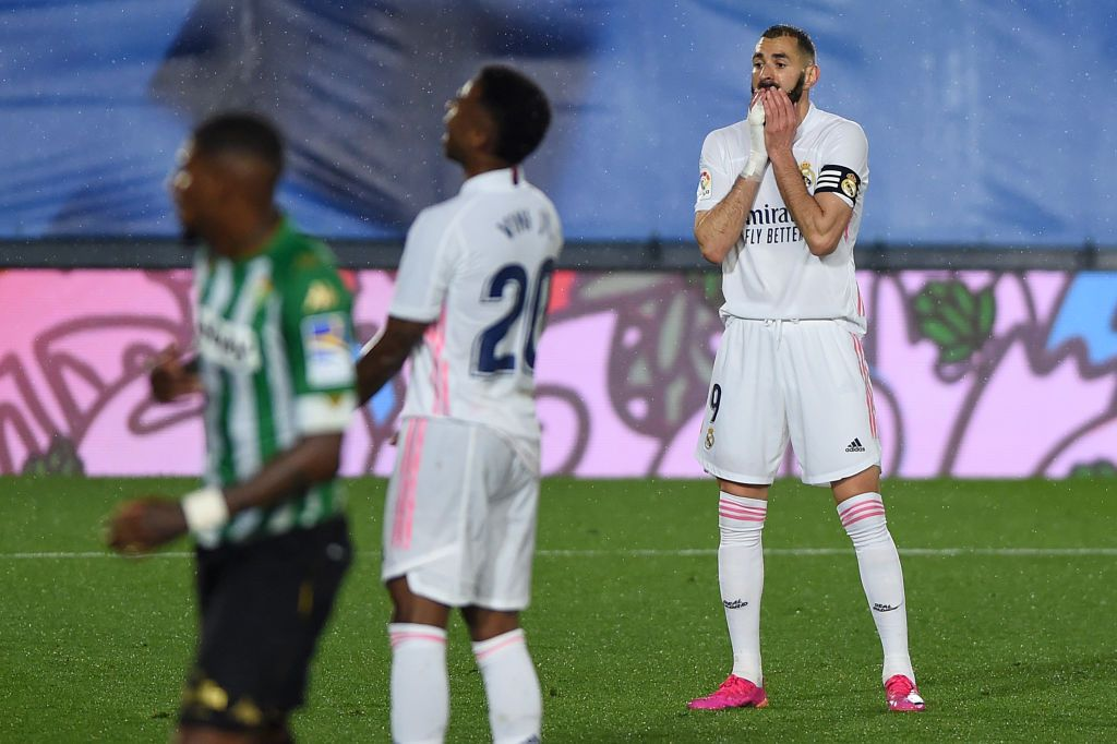 MADRID, SPAIN - APRIL 24: Karim Benzema of Real Madrid  reacts after a missed chance during the La Liga Santander match between Real Madrid and Real Betis at Estadio Santiago Bernabeu on April 24, 2021 in Madrid, Spain. Sporting stadiums around Spain remain under strict restrictions due to the Coronavirus Pandemic as Government social distancing laws prohibit fans inside venues resulting in games being played behind closed doors. (Photo by Denis Doyle/Getty Images)