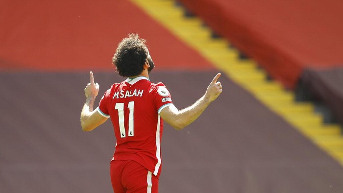 Liverpools Mohamed Salah celebrates after scoring his sides opening goal during the English Premier League soccer match between Liverpool and Newcastle United at Anfield stadium in Liverpool, England, Saturday, April 24, 2021. (David Klein, Pool via AP)