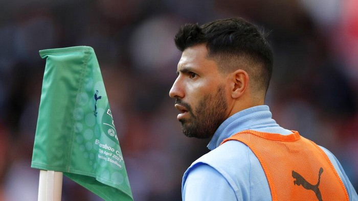 Manchester Citys Sergio Aguero warms up by the touchline during the English League Cup final soccer match between Manchester City and Tottenham Hotspur at Wembley stadium in London, Sunday, April 25, 2021. (AP Photo/Alastair Grant)