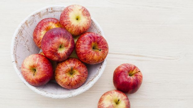 Royal gala apples on wooden background