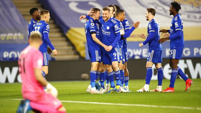 Leicester City players celebrate after Leicesters Timothy Castagne scored his sides opening goal during the English Premier League soccer match between Leicester City and Crystal Palace at the King Power Stadium in Leicester, England, Monday, April 26, 2021. (Andrew Boyers/Pool via AP)