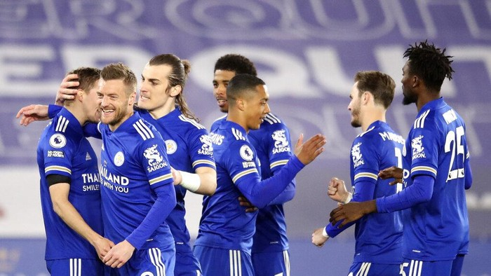 Leicester City players celebrate after Leicesters Timothy Castagne, left, scored his sides opening goal during the English Premier League soccer match between Leicester City and Crystal Palace at the King Power Stadium in Leicester, England, Monday, April 26, 2021. (Alex Pantling/Pool via AP)