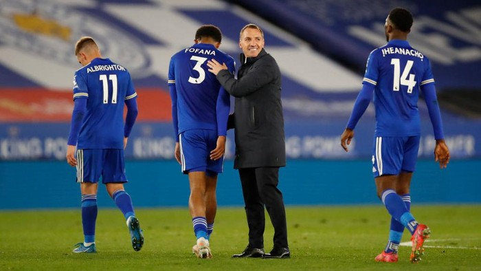 LEICESTER, ENGLAND - APRIL 26: Brendan Rogers, Manager of Leicester City celebrates on full time with Wesley Fofana of Leicester City  during the Premier League match between Leicester City and Crystal Palace at The King Power Stadium on April 26, 2021 in Leicester, England. Sporting stadiums around the UK remain under strict restrictions due to the Coronavirus Pandemic as Government social distancing laws prohibit fans inside venues resulting in games being played behind closed doors.  (Photo by Andrew Boyers - Pool/Getty Images)