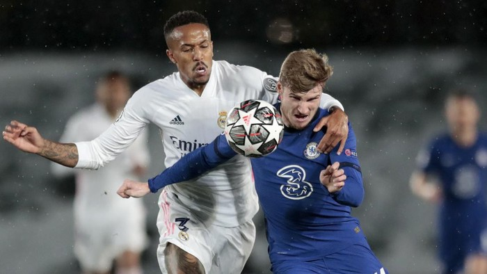 Chelseas Timo Werner vies for the ball with Real Madrids Eder Militao, left, during the Champions League semifinal first leg soccer match between Real Madrid and Chelsea at the Alfredo di Stefano stadium in Madrid, Spain, Tuesday, April 27, 2021. (AP Photo/Bernat Armangue)