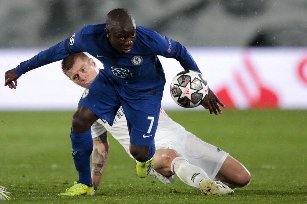 Chelsea's N'Golo Kante gets the ball past Real Madrid's Toni Kroos, in the background, during the Champions League semifinal first leg soccer match between Real Madrid and Chelsea at the Alfredo di Stefano stadium in Madrid, Spain, Tuesday, April 27, 2021. (AP Photo/Bernat Armangue)