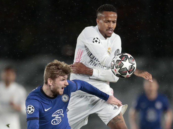 Chelseas Timo Werner vies for the ball with Real Madrids Eder Militao, right, during the Champions League semifinal first leg soccer match between Real Madrid and Chelsea at the Alfredo di Stefano stadium in Madrid, Spain, Tuesday, April 27, 2021. (AP Photo/Bernat Armangue)