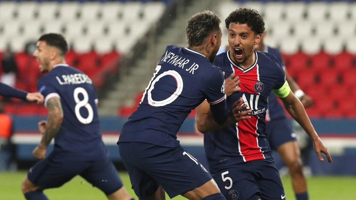 PSGs Marquinhos, right, celebrates with PSGs Neymar after scoring his sides first goal during the Champions League semifinal first leg soccer match between Paris Saint Germain and Manchester City at the Parc des Princes stadium, in Paris, France , Wednesday, April 28, 2021. (AP Photo/Thibault Camus)