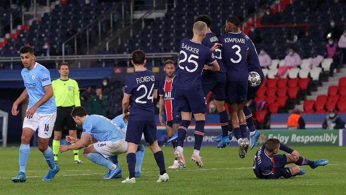 PARIS, FRANCE - APRIL 28: Riyad Mahrez (not in the picture) of Manchester City scores their sides second goal during the UEFA Champions League Semi Final First Leg match between Paris Saint-Germain and Manchester City at Parc des Princes on April 28, 2021 in Paris, France. Sporting stadiums around France remain under strict restrictions due to the Coronavirus Pandemic as Government social distancing laws prohibit fans inside venues resulting in games being played behind closed doors. (Photo by Alex Grimm/Getty Images)