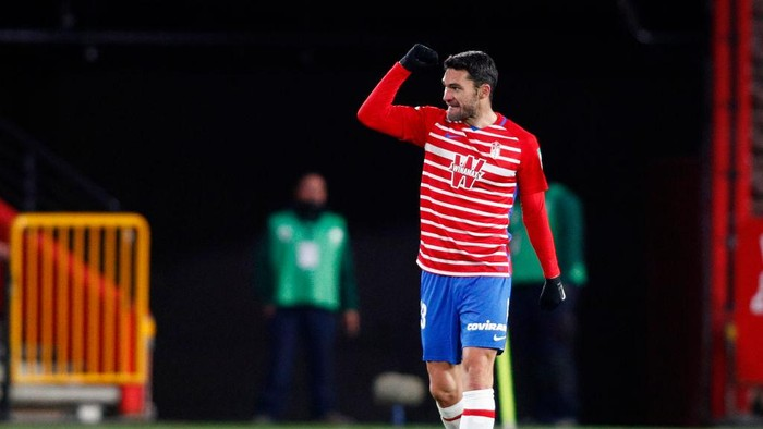 GRANADA, SPAIN - DECEMBER 30: Jorge Molina of Granada CF celebrates after scoring his sides second goal during the La Liga Santander match between Granada CF and Valencia CF at Estadio Nuevo Los Carmenes on December 30, 2020 in Granada, Spain. Sporting stadiums around Spain remain under strict restrictions due to the Coronavirus Pandemic as Government social distancing laws prohibit fans inside venues resulting in games being played behind closed doors. (Photo by Fran Santiago/Getty Images)
