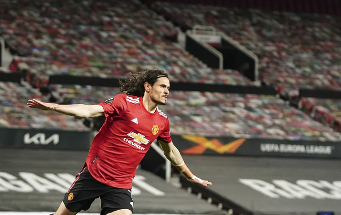 Manchester Uniteds Edinson Cavani celebrates after scoring his sides second goal during the Europa League semi final, first leg soccer match between Manchester United and Roma at Old Trafford in Manchester, England, Thursday, April 29, 2021. (AP Photo/Jon Super)