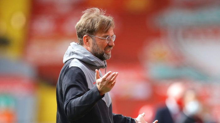 LIVERPOOL, ENGLAND - APRIL 24: Juergen Klopp, Manager of Liverpool is interviewed prior to the Premier League match between Liverpool and Newcastle United at Anfield on April 24, 2021 in Liverpool, England. Sporting stadiums around the UK remain under strict restrictions due to the Coronavirus Pandemic as Government social distancing laws prohibit fans inside venues resulting in games being played behind closed doors.  (Photo by David Klein - Pool/Getty Images)
