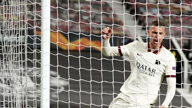 Roma's Edin Dzeko celebrates after scoring his side's second goal during the Europa League semi final, first leg soccer match between Manchester United and Roma at Old Trafford in Manchester, England, Thursday, April 29, 2021. (AP Photo/Jon Super)