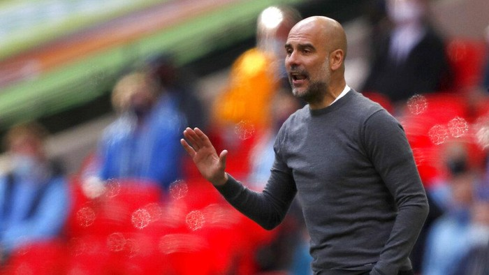 Manchester Citys head coach Pep Guardiola gestures during the English League Cup final soccer match between Manchester City and Tottenham Hotspur at Wembley stadium in London, Sunday, April 25, 2021. (AP Photo/Alastair Grant)