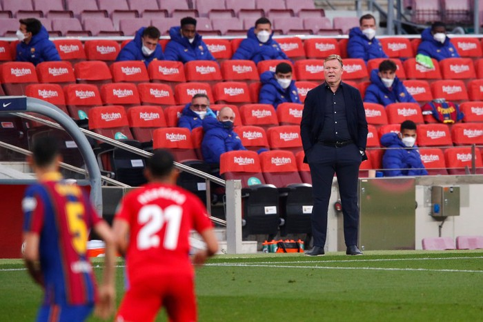 BARCELONA, SPAIN - APRIL 29: Ronald Koeman, Head coach of FC Barcelona looks on during the La Liga Santander match between FC Barcelona and Granada CF at Camp Nou on April 29, 2021 in Barcelona, Spain. Sporting stadiums around Spain remain under strict restrictions due to the Coronavirus Pandemic as Government social distancing laws prohibit fans inside venues resulting in games being played behind closed doors. (Photo by Eric Alonso/Getty Images)