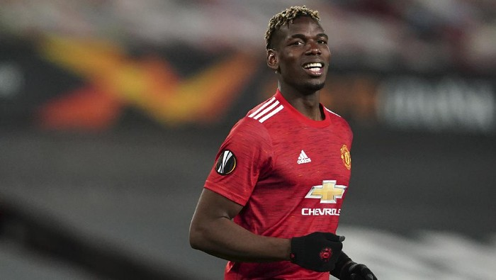 Manchester Uniteds Paul Pogba smiles during the Europa League semi final, first leg soccer match between Manchester United and Roma at Old Trafford in Manchester, England, Thursday, April 29, 2021. (AP Photo/Jon Super)