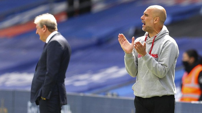 Manchester Citys head coach Pep Guardiola gestures as he watches play during the English Premier League soccer match between Crystal Palace and Manchester City at Selhurst Park in London, England, Saturday, May 1, 2021. (AP Photo/Catherine Ivill/Pool)
