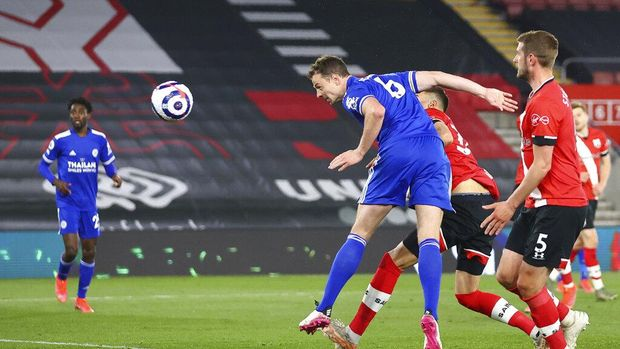 Leicester's Jonny Evans scores his side's opening goal during the English Premier League soccer match between Southampton and Leicester City at St. Mary's Stadium in Southampton, England, Friday, April 30, 2021. (Michael Steele/Pool via AP)