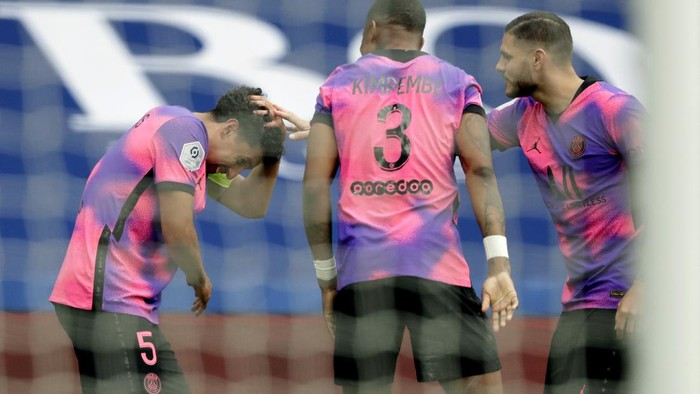 PSGs Marquinhos, left, celebrates after scoring his sides second goal during the French League One soccer match between Paris Saint-Germain and Lens at the Parc des Princes stadium in Paris, France, Saturday, May 1, 2021. (AP Photo/Thibault Camus)