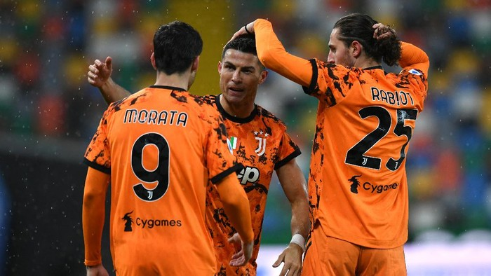 UDINE, ITALY - MAY 02: Cristiano Ronaldo of Juventus celebrates with team mates (L - R) Alvaro Morata and Adrien Rabiot after scoring their sides second goal during the Serie A match between Udinese Calcio and Juventus  at Dacia Arena on May 02, 2021 in Udine, Italy. Sporting stadiums around Italy remain under strict restrictions due to the Coronavirus Pandemic as Government social distancing laws prohibit fans inside venues resulting in games being played behind closed doors. (Photo by Alessandro Sabattini/Getty Images)