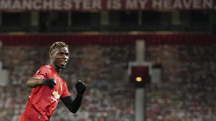 Manchester Uniteds Paul Pogba celebrates after scoring his sides fifth goal during the Europa League semi final, first leg soccer match between Manchester United and Roma at Old Trafford in Manchester, England, Thursday, April 29, 2021. (AP Photo/Jon Super)
