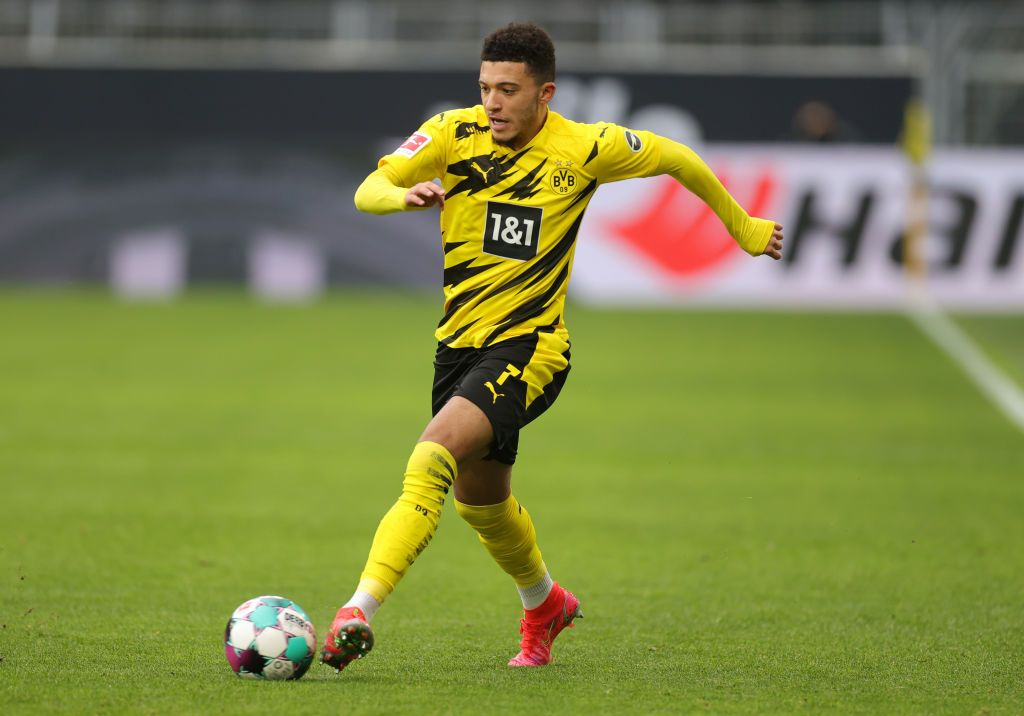 DORTMUND, GERMANY - FEBRUARY 27: Jadon Sancho of Borussia Dortmund passes the ball during the Bundesliga match between Borussia Dortmund and DSC Arminia Bielefeld at Signal Iduna Park on February 27, 2021 in Dortmund, Germany. Sporting stadiums around Germany remain under strict restrictions due to the Coronavirus Pandemic as Government social distancing laws prohibit fans inside venues resulting in games being played behind closed doors. (Photo by Friedemann Vogel - Pool/Getty Images)