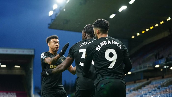 BURNLEY, ENGLAND - MAY 03: Michail Antonio of West Ham United celebrates with Jesse Lingard and Said Benrahma after scoring their sides second goal during the Premier League match between Burnley and West Ham United at Turf Moor on May 03, 2021 in Burnley, England. Sporting stadiums around the UK remain under strict restrictions due to the Coronavirus Pandemic as Government social distancing laws prohibit fans inside venues resulting in games being played behind closed doors.  (Photo by Jon Super - Pool/Getty Images)