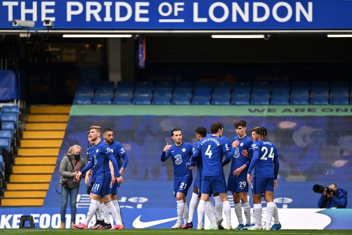LONDON, ENGLAND - MAY 01: Kai Havertz of Chelsea celebrates with Andreas Christensen and Reece James after scoring their sides first goal during the Premier League match between Chelsea and Fulham at Stamford Bridge on May 01, 2021 in London, England. Sporting stadiums around the UK remain under strict restrictions due to the Coronavirus Pandemic as Government social distancing laws prohibit fans inside venues resulting in games being played behind closed doors. (Photo by Justin Setterfield/Getty Images)