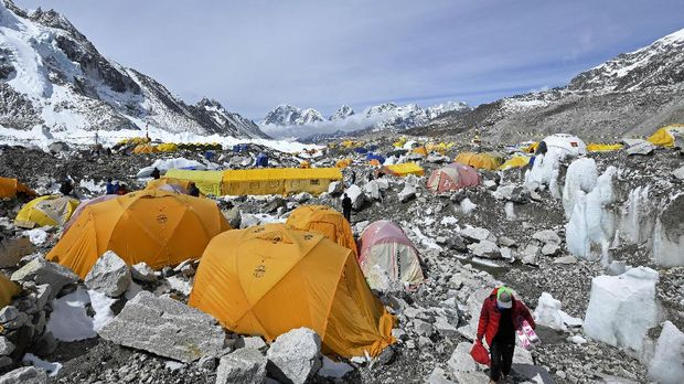 Tents of mountaineers are pictured at the Everest base camp in the Mount Everest region of Solukhumbu district on May 3, 2021. (Photo by Prakash MATHEMA / AFP)