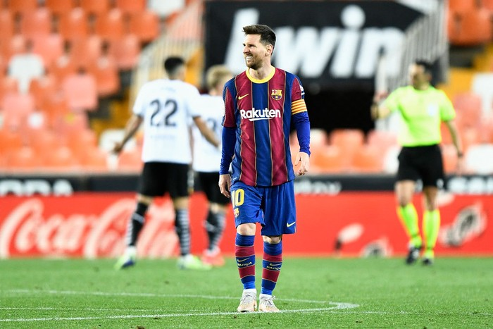 VALENCIA, SPAIN - MAY 02: Lionel Messi of FC Barcelona reacts after scoring their sides first goal during the La Liga Santander match between Valencia CF and FC Barcelona at Estadio Mestalla on May 02, 2021 in Valencia, Spain. Sporting stadiums around Spain remain under strict restrictions due to the Coronavirus Pandemic as Government social distancing laws prohibit fans inside venues resulting in games being played behind closed doors. (Photo by Aitor Alcalde/Getty Images)