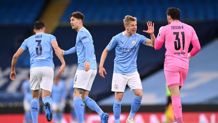 MANCHESTER, ENGLAND - MAY 04: Oleksandr Zinchenko of Manchester City celebrates his sides first goal which came from a Riyad Mahrez (not pictured) goal with Ederson of Manchester City during the UEFA Champions League Semi Final Second Leg match between Manchester City and Paris Saint-Germain at Etihad Stadium on May 04, 2021 in Manchester, England. Sporting stadiums around the UK remain under strict restrictions due to the Coronavirus Pandemic as Government social distancing laws prohibit fans inside venues resulting in games being played behind closed doors. (Photo by Laurence Griffiths/Getty Images)