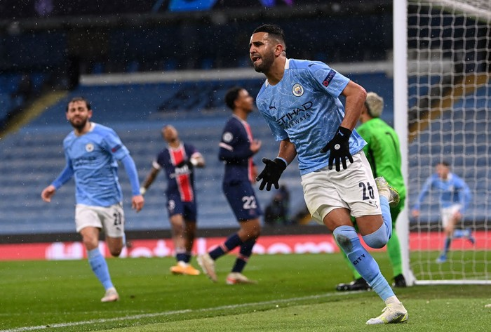 MANCHESTER, ENGLAND - MAY 04: Riyad Mahrez of Manchester City celebrates after scoring his teams second goal during the UEFA Champions League Semi Final Second Leg match between Manchester City and Paris Saint-Germain at Etihad Stadium on May 04, 2021 in Manchester, England. Sporting stadiums around the UK remain under strict restrictions due to the Coronavirus Pandemic as Government social distancing laws prohibit fans inside venues resulting in games being played behind closed doors. (Photo by Laurence Griffiths/Getty Images)