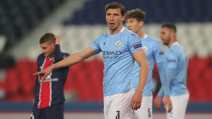 PARIS, FRANCE - APRIL 28: Ruben Dias of Manchester City reacts during the UEFA Champions League Semi Final First Leg match between Paris Saint-Germain and Manchester City at Parc des Princes on April 28, 2021 in Paris, France. Sporting stadiums around France remain under strict restrictions due to the Coronavirus Pandemic as Government social distancing laws prohibit fans inside venues resulting in games being played behind closed doors. (Photo by Alex Grimm/Getty Images)