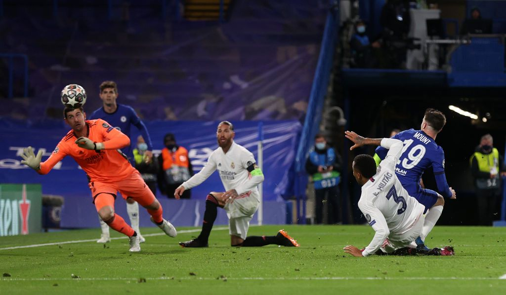 LONDON, ENGLAND - MAY 05: Mason Mount of Chelsea scores his team's second goal past Thibaut Courtois of Real Madrid during the UEFA Champions League Semi Final Second Leg match between Chelsea and Real Madrid at Stamford Bridge on May 05, 2021 in London, England. Sporting stadiums around Europe remain under strict restrictions due to the Coronavirus Pandemic as Government social distancing laws prohibit fans inside venues resulting in games being played behind closed doors. (Photo by Clive Rose/Getty Images)