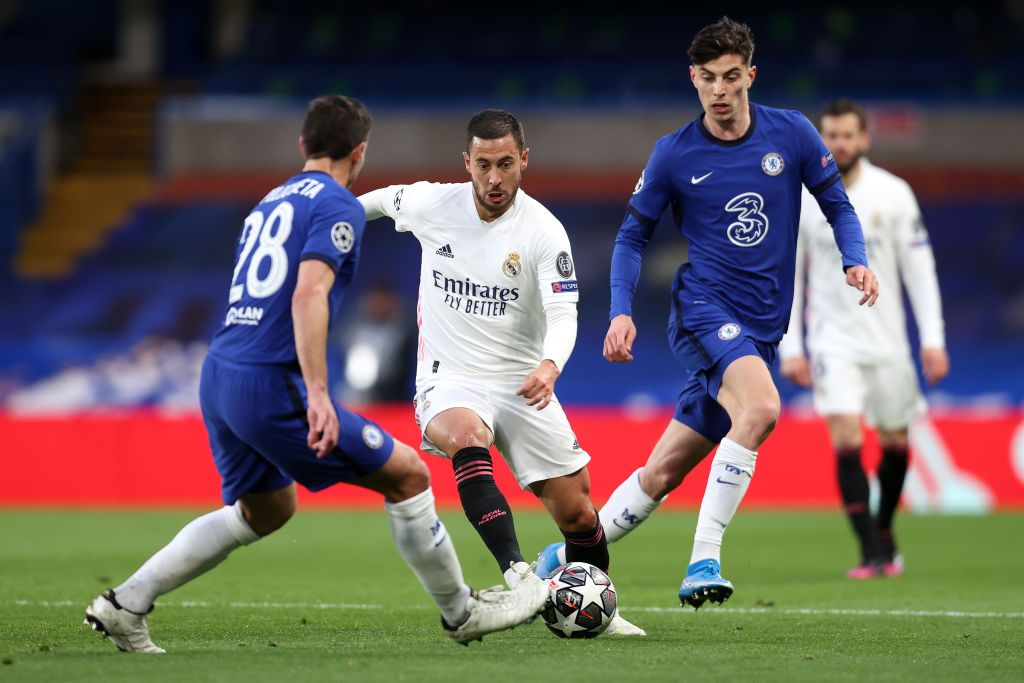 LONDON, ENGLAND - MAY 05: Eden Hazard of Real Madrid is closed down by Cesar Azpilicueta and Kai Havertz of Chelsea during the UEFA Champions League Semi Final Second Leg match between Chelsea and Real Madrid at Stamford Bridge on May 05, 2021 in London, England. Sporting stadiums around Europe remain under strict restrictions due to the Coronavirus Pandemic as Government social distancing laws prohibit fans inside venues resulting in games being played behind closed doors. (Photo by Clive Rose/Getty Images)
