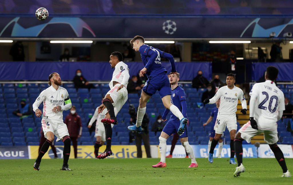 LONDON, ENGLAND - MAY 05: Kai Havertz of Chelsea battles for possession with Sergio Ramos of Real Madrid during the UEFA Champions League Semi Final Second Leg match between Chelsea and Real Madrid at Stamford Bridge on May 05, 2021 in London, England. Sporting stadiums around Europe remain under strict restrictions due to the Coronavirus Pandemic as Government social distancing laws prohibit fans inside venues resulting in games being played behind closed doors. (Photo by Clive Rose/Getty Images)