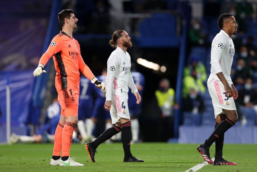 LONDON, ENGLAND - MAY 05: (L-R) Thibaut Courtois, Sergio Ramos and Eder Militao of Real Madrid look dejected after conceding a second goal during the UEFA Champions League Semi Final Second Leg match between Chelsea and Real Madrid at Stamford Bridge on May 05, 2021 in London, England. Sporting stadiums around Europe remain under strict restrictions due to the Coronavirus Pandemic as Government social distancing laws prohibit fans inside venues resulting in games being played behind closed doors. (Photo by Clive Rose/Getty Images)