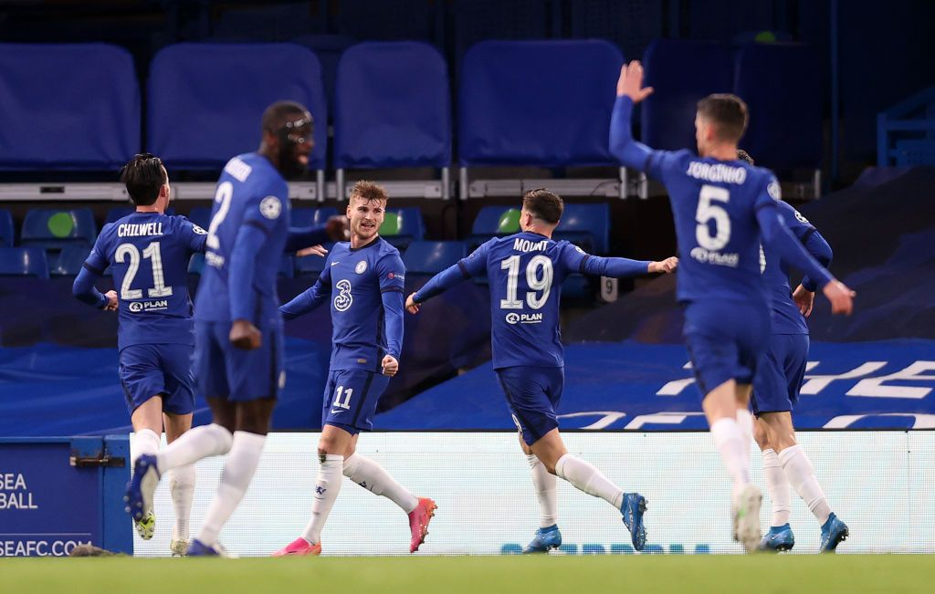 LONDON, ENGLAND - MAY 05: Timo Werner of Chelsea celebrates with teammates after scoring their team's first goal during the UEFA Champions League Semi Final Second Leg match between Chelsea and Real Madrid at Stamford Bridge on May 05, 2021 in London, England. Sporting stadiums around Europe remain under strict restrictions due to the Coronavirus Pandemic as Government social distancing laws prohibit fans inside venues resulting in games being played behind closed doors. (Photo by Clive Rose/Getty Images)