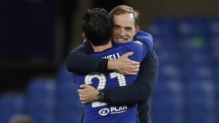 Chelseas head coach Thomas Tuchel celebrates with Ben Chilwell at the end of the Champions League semifinal 2nd leg soccer match between Chelsea and Real Madrid at Stamford Bridge in London, Wednesday, May 5, 2021. Chelsea won 2-0. (AP Photo/Alastair Grant)