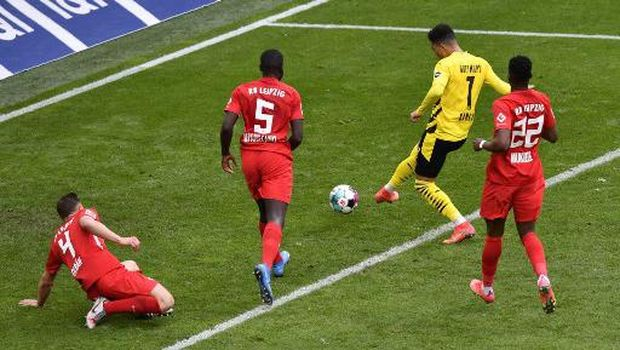 Dortmund's English midfielder Jadon Sancho scores his side's third goal during the German first division Bundesliga football match BVB Borussia Dortmund v RB Leipzig in Dortmund, western Germany on May 8, 2021. (Photo by Martin Meissner / POOL / AFP) / DFL REGULATIONS PROHIBIT ANY USE OF PHOTOGRAPHS AS IMAGE SEQUENCES AND/OR QUASI-VIDEO