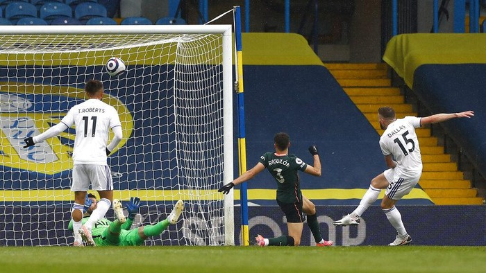 Leeds Uniteds Stuart Dallas, right, scores his teams first goal during the English Premier League soccer match between Leeds United and Tottenham Hotspur at Elland Road in Leeds, England, Saturday, May 8, 2021. (AP Photo/Jason Cairnduff/Pool)