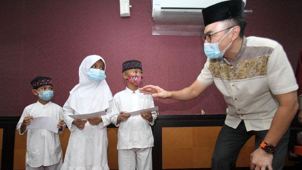 Momen Berbagi Bersama  Anak Yatim dan Dhuafa