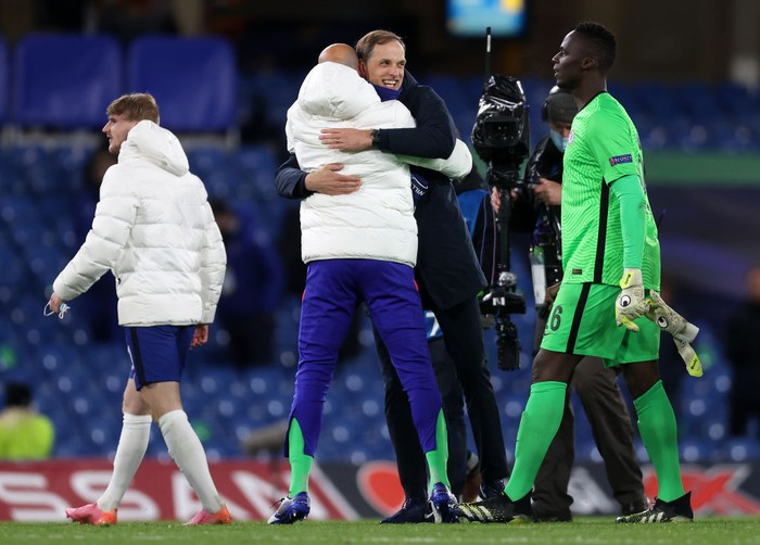 LONDON, ENGLAND - MAY 05: Willy Caballero and Edouard Mendy of Chelsea celebrate with Thomas Tuchel, Manager of Chelsea following victory during the UEFA Champions League Semi Final Second Leg match between Chelsea and Real Madrid at Stamford Bridge on May 05, 2021 in London, England. Sporting stadiums around Europe remain under strict restrictions due to the Coronavirus Pandemic as Government social distancing laws prohibit fans inside venues resulting in games being played behind closed doors. (Photo by Clive Rose/Getty Images)